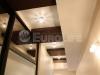 Двухуровневый комбинированный натяжной потолок.