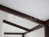 Матовые белые натяжные потолки через балки.