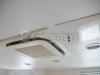 Система внедрения кондиционера и лючка обслуживания в натяжной потолок.