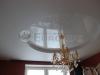 Двухуровневый натяжной потолок ПВХ в спальне в классическом стиле.