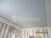 Матовый натяжной потолок. Полотно смонтировано в гипсокартонную конструкцию с закарнизным пространством.