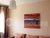 Матовый белый натяжной потолок в гостиной