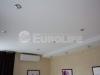 Двухуровневый тканевый натяжной потолок в спальне